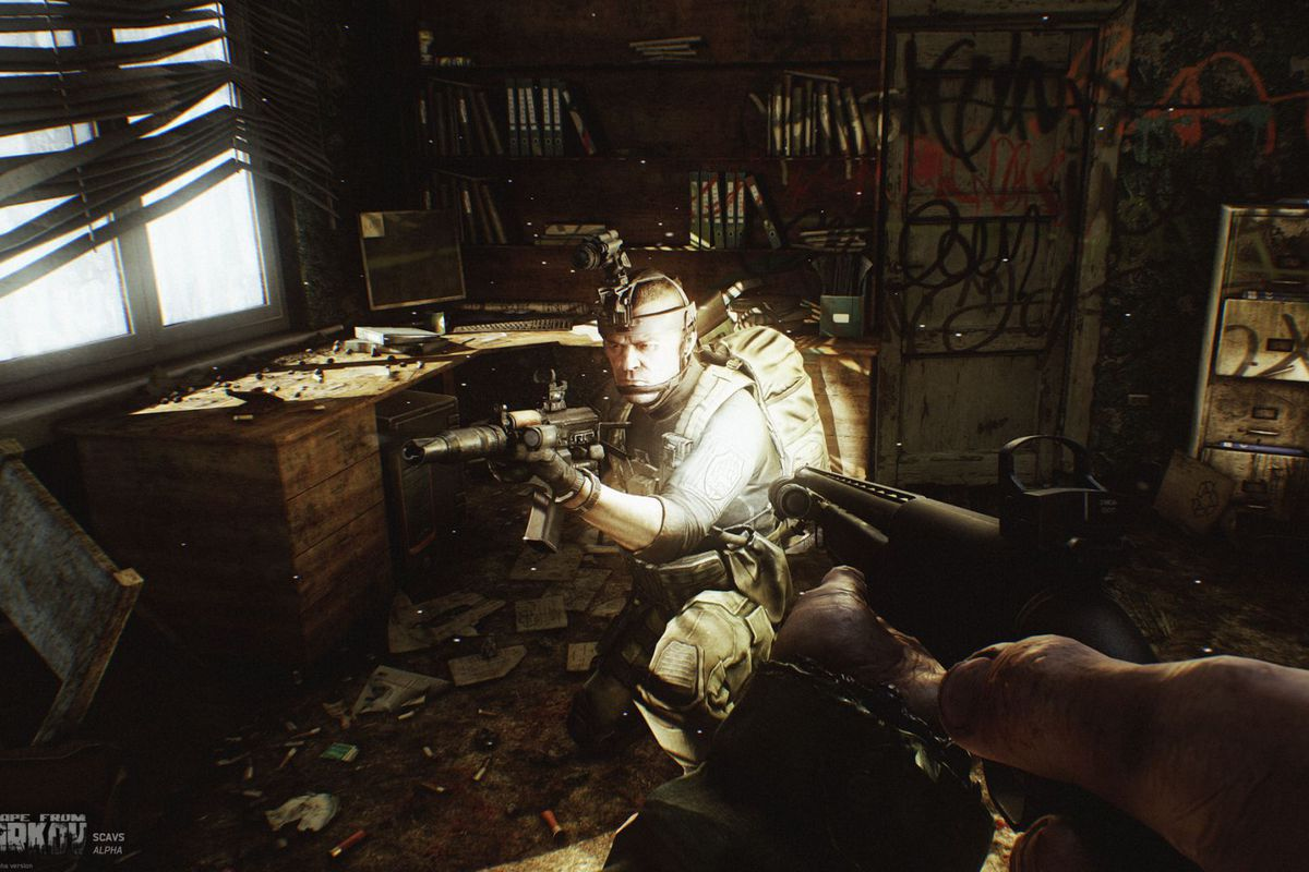 A player hunkers down in a filthy room, covered in tactical kit.