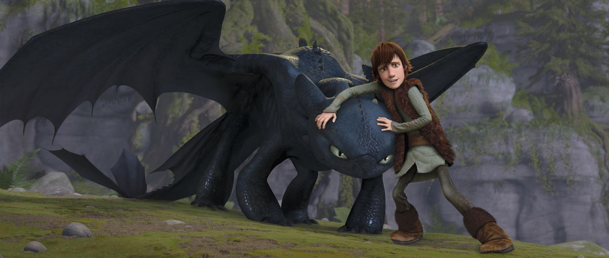 hiccup nervously stands next to toothless, who looks kinda pissed off, in How to Train Your Dragon