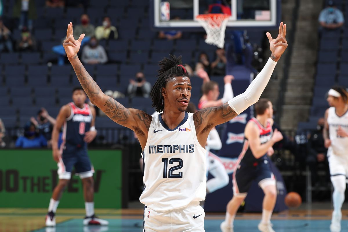 Ja Morant #12 of the Memphis Grizzlies puts his hands in the air during the game against the Washington Wizards on March 10, 2021 at FedExForum in Memphis, Tennessee.