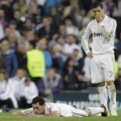 Real Madrid Alvaro Arbeloa, left, and Cristiano Ronaldo from Portugal look away from the penalty shootout during a semifinal, second leg Champions League soccer match at the Santiago Bernabeu stadium in Madrid Wednesday, April 25, 2012. Bayen Munich won the match and go through to the final.