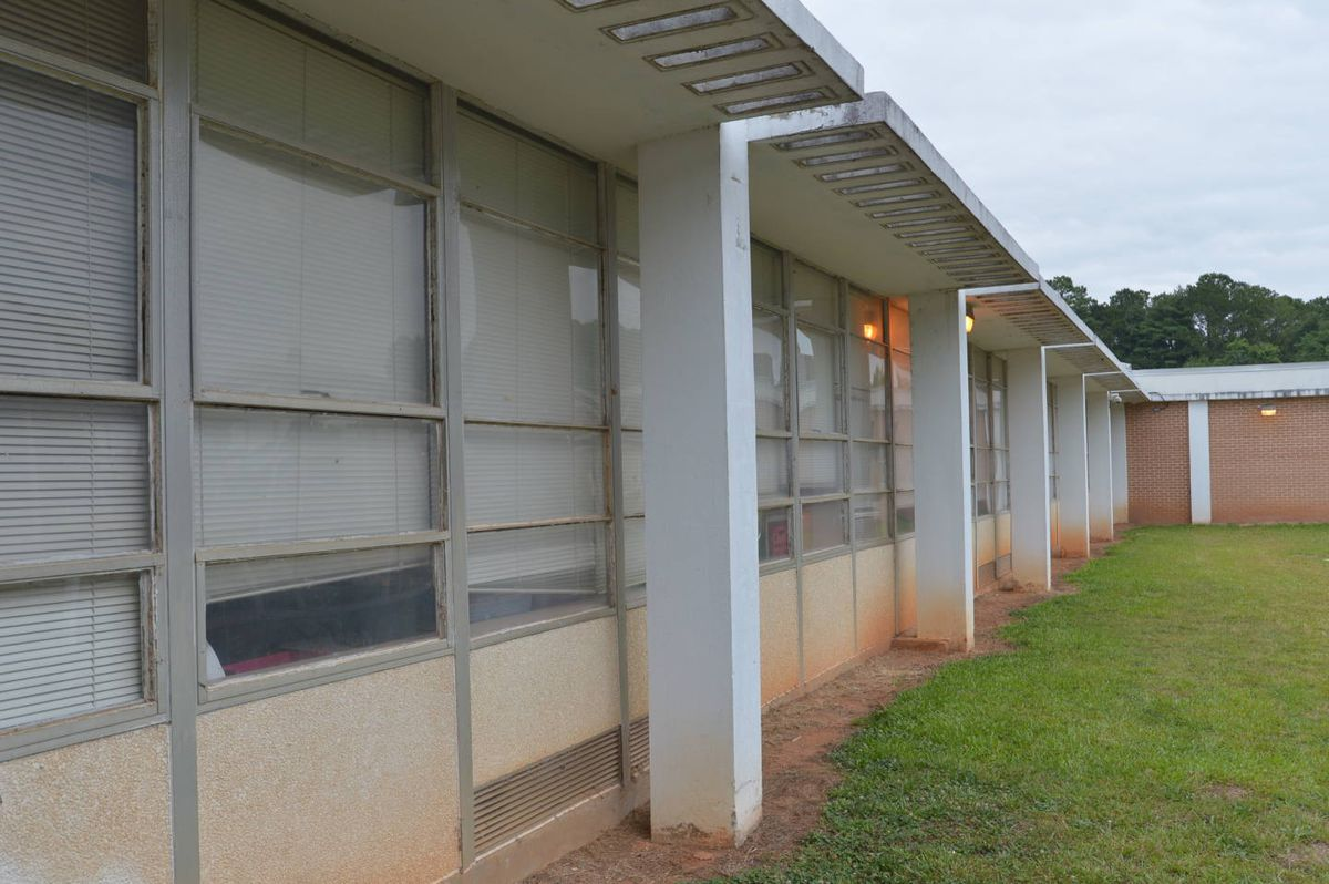 The exterior of a 1960s school of brick designed by famous architect John Portman.