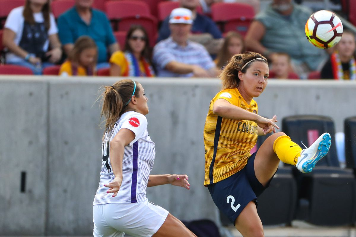 Utah Royals FC forward Rachel Corsie (2) chips a perfect pass to teammate Utah Royals FC forward Amy Rodriguez (8) who finished with a goal during during a soccer match against Orlando Pride at Rio Tinto Stadium in Sandy on Saturday, July 14, 2018.
