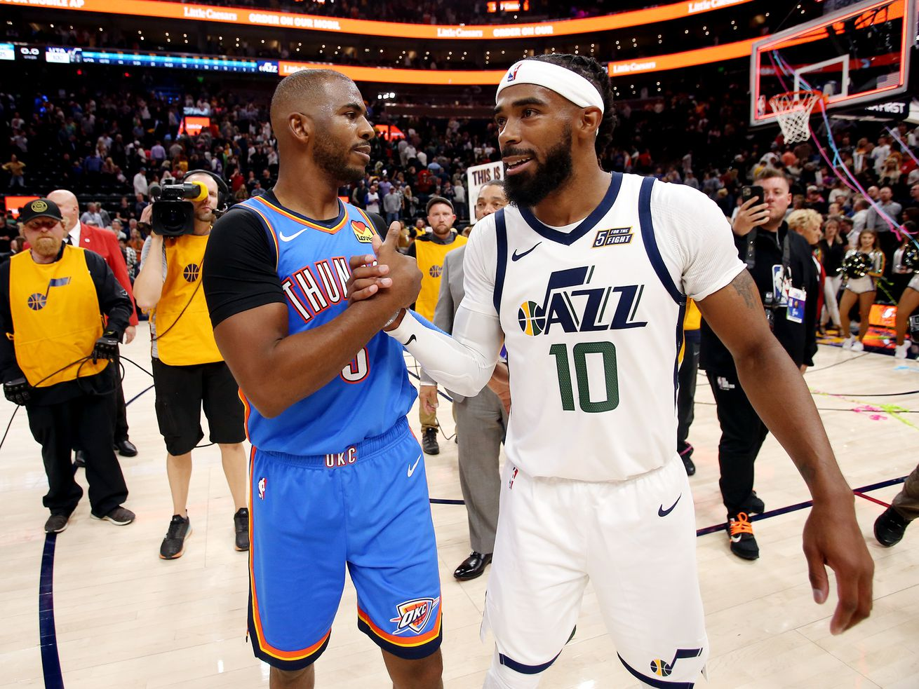 Oklahoma City Thunder guard Chris Paul (3) and Utah Jazz guard Mike Conley (10) talk after the game as the Jazz open the 2019/20 season with win over the Thunder at Vivint Smart Home Arena in Salt Lake City on Wednesday, Oct. 23, 2019. Utah won 100-95.