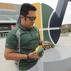 Utah Jazz fan Nate Salazar brings a tractor and a ball to place an informal memorial outside Vivint Arena in downtown Salt Lake City on Friday, May 22, 2020, after former coach Jerry Sloan died at age 78.