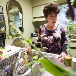 Eugenia Sutcliffe talks about some of her plants as she discusses aging and how she deals with it, at her home in Salt Lake City on Monday, March 27, 2017.