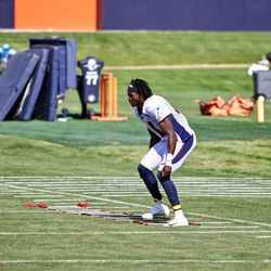 Rookie CB Isaac Yiadom moves his restricted feet through the ladder.