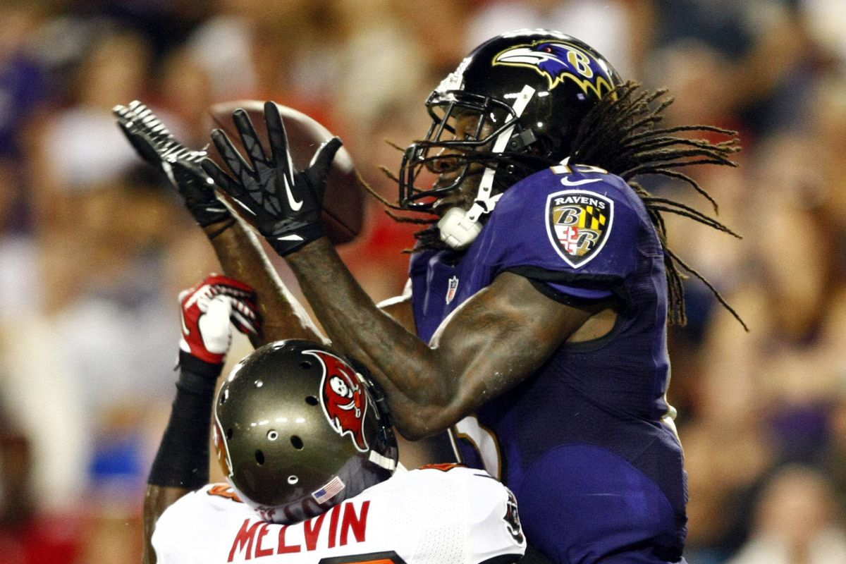 LaQuan Williams, seen catching a touchdown in a preseason game last year, has re-signed with the Baltimore Ravens.