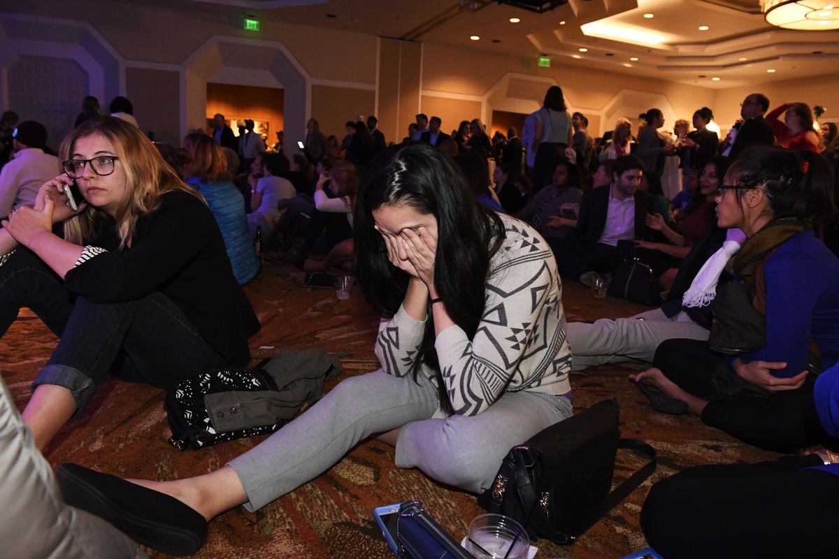 People look stunned as the numbers continue to turn in favor of Republican candidate Donald Trump and against Democratic candidate Hillary Clinton at the Democratic Election night party at at the Denver Westin Downtown on November 8, 2016 in Denver, Color