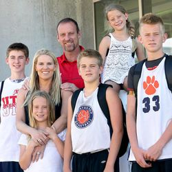 Larry Krystkowiak poses for a photo with his family at the University of Utah in Salt Lake City on Friday, June 12, 2015. Finley is in front. Sam is on the top row. And from left in the middle are Cameron, Jan, Ben, and Luc.