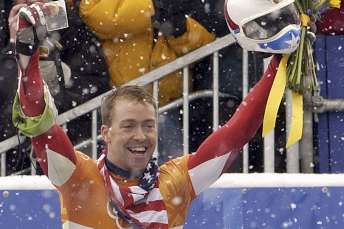 In this Feb. 20, 2002, file photo, Jimmy Shea of the United States holds a photograph of his grandfather as he celebrates his gold medal winning run after the men's skeleton final at the Salt Lake City Winter Olympics in Park City, Utah. Shea has been charged with sexual abuse of a child in Utah.