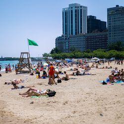 People cool off at Oak Street Beach on July 24, 2019.