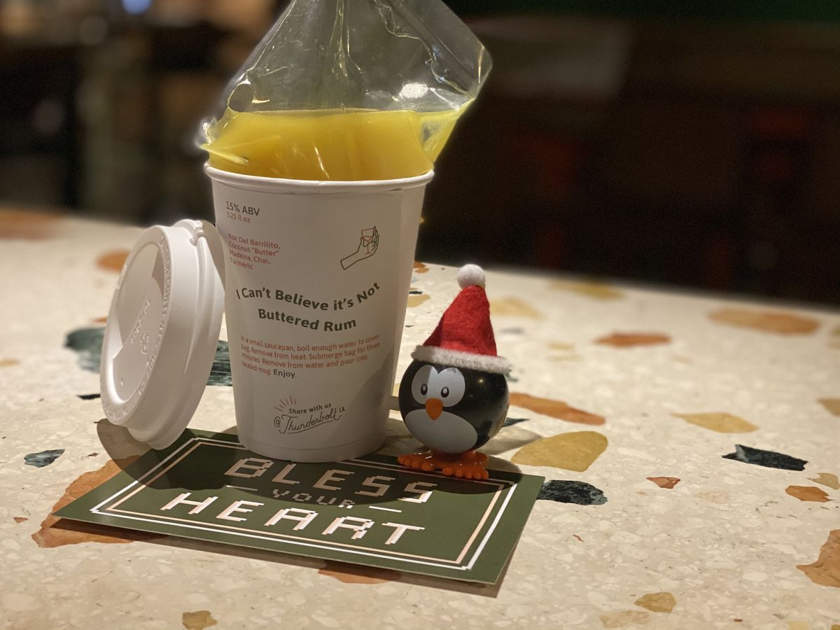 A slushie cocktail in a paper cup ready for the holidays.