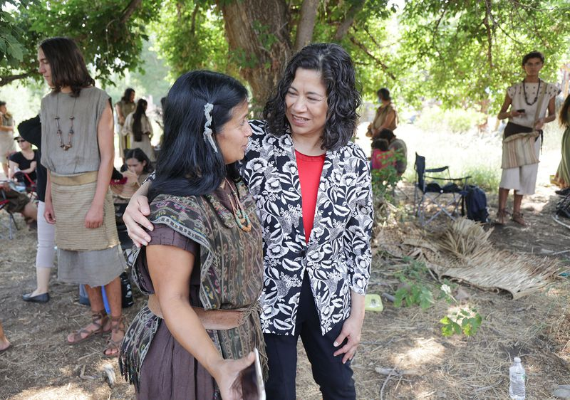 Sister Reyna Aburto, right, speaks to cast member Stella Hall from Gilbert, Arizona, during production of the Book of Mormon video series.