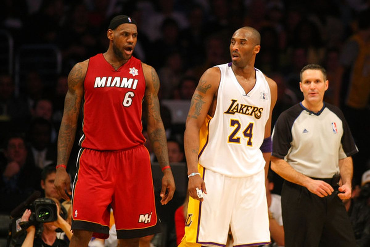 LeBron James exchanges words with Kobe Bryant late in the fourth quarter during the NBA game at Staples Center on December 25 2010 in Los Angeles California. The Heat defeated the Lakers 96-80.