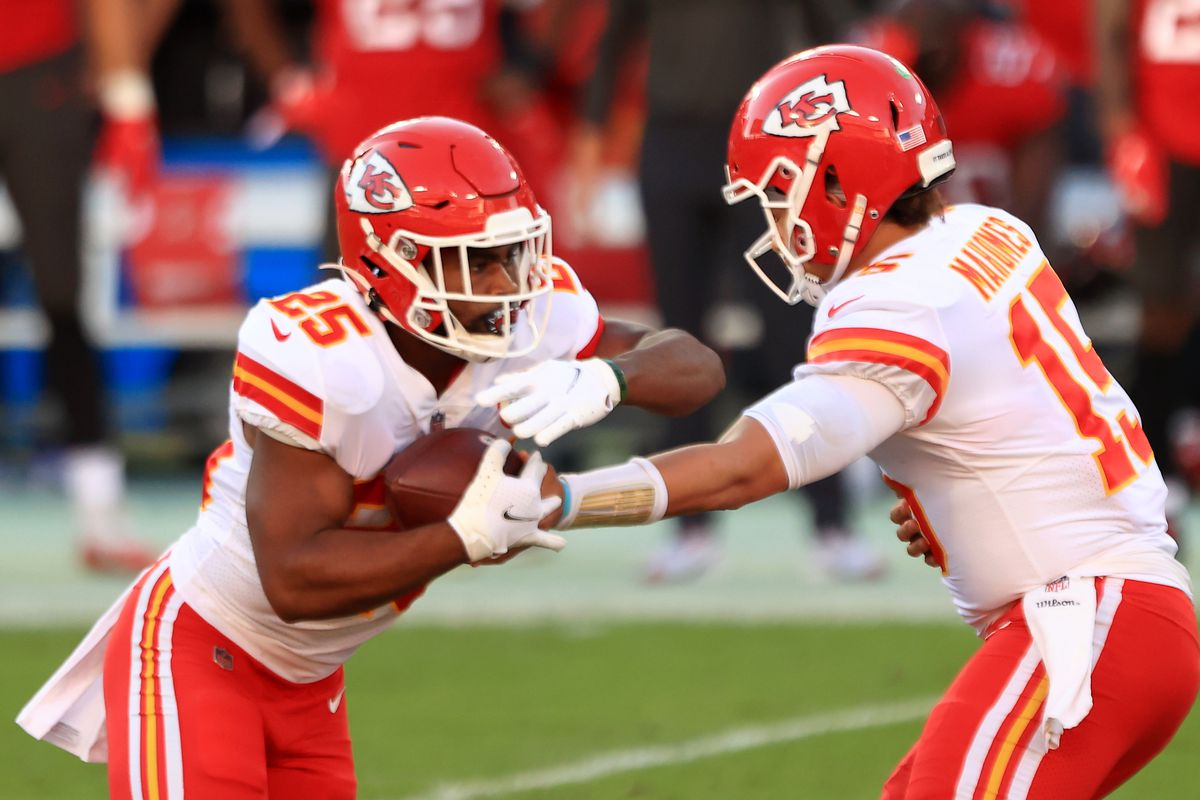 Patrick Mahomes #15 of the Kansas City Chiefs hands the ball to teammate Clyde Edwards-Helaire #25 in the first quarter during their game against the Tampa Bay Buccaneers at Raymond James Stadium on November 29, 2020 in Tampa, Florida.