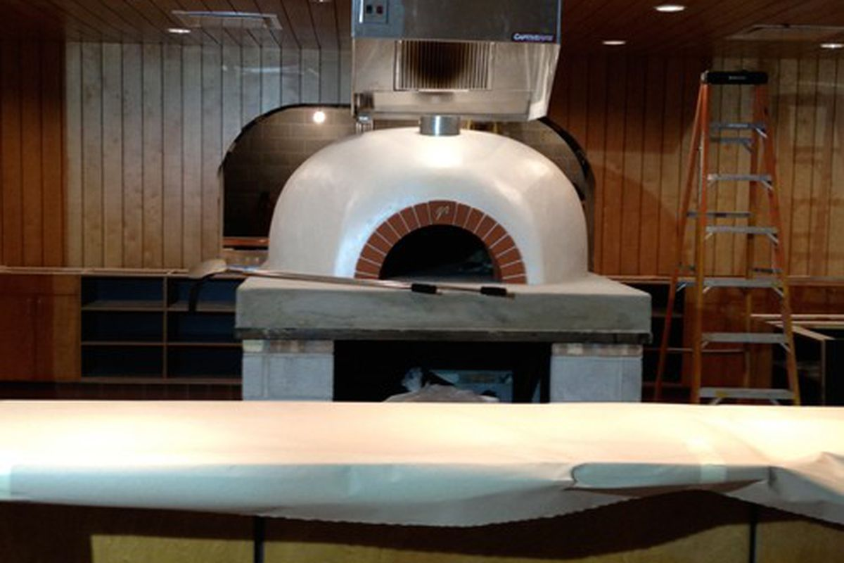 The centerpiece -- a new wood-burning oven that will cook pizzas in two minutes