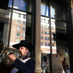 Jacob Douglas of the  Herriman High School marching band plays outside the new Macy's store at City Creek during the mall's grand opening Thursday,  March 22, 2012.