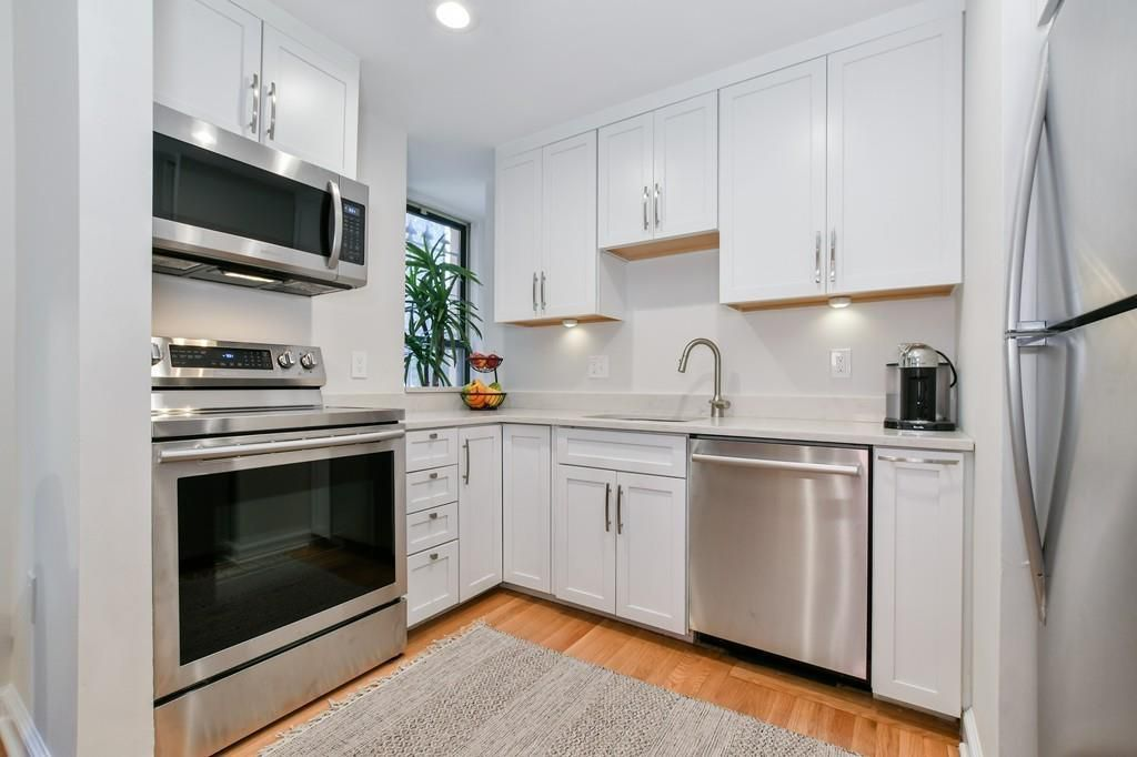 A modern kitchen with an L-shaped counter.