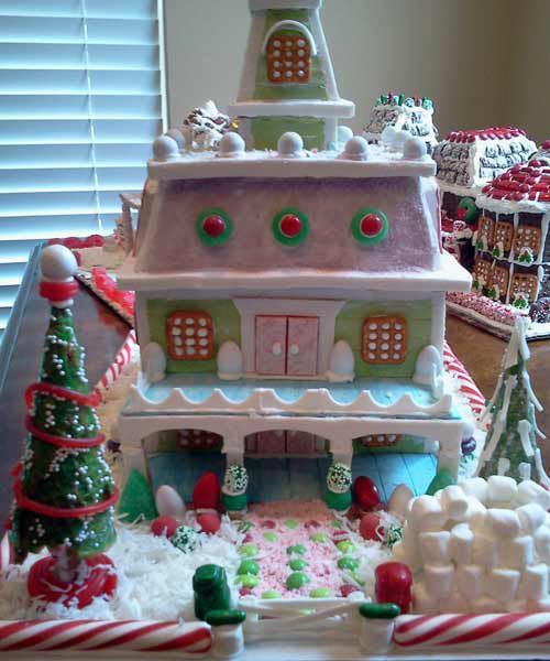 Front of the Jordan Gingerbread House with pink, blue, and green exterior.