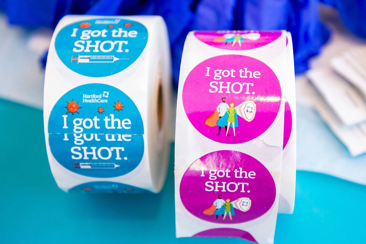 """Two rolls of blue and pink stickers that say """"I got the SHOT."""""""