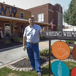 In this Aug. 29, 2012 photo, Jim Bolin stands in front of the Whitling Whimsey restaurant next to the world's largest wind chime in Casey, Ill. He hopes that the attraction and restaurant will attract not only visitors but businesses to the Casey area. The wind chime was created by Jim Bolin and will be in the 2013 Guinness Book of World Records.