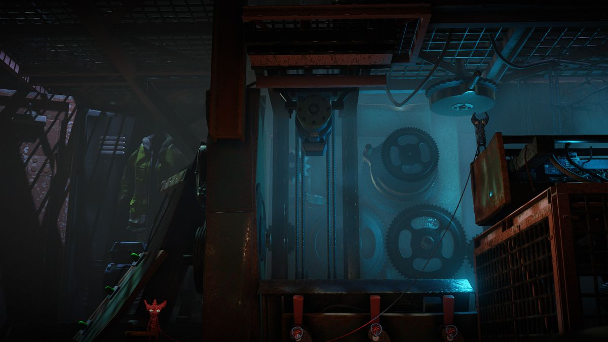 Unravel 2 - Yarny standing in front of a big machine
