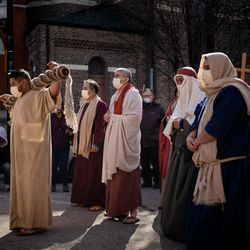 People join a procession during Via Crucis in Pilsen, Friday morning, April 2, 2021. The annual Via Crucis is a Good Friday tradition that reenacts the Stations of the Cross, a Catholic devotion that recounts Jesus' passion and death.