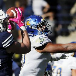 Brigham Young Cougars tight end Matt Bushman pulls in a pass with San Jose State Spartans safety Ethan Aguayo defending during NCAA football in Provo on Saturday, Oct. 28, 2017.