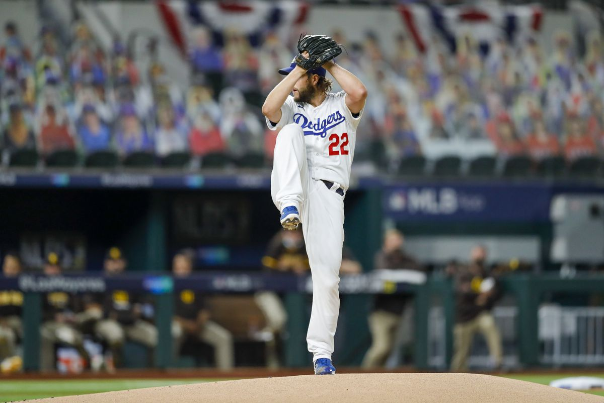 Clayton Kershaw #22 of the Los Angeles Dodgers pitches in the first inning during Game 2 of the NLDS between the Los Angeles Dodgers and the San Diego Padres at Globe Life Field on Wednesday, October 7, 2020 in Arlington, Texas.