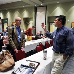 Bree Martin, left, Wesley Smith and Bill Wilson talk during a break between courses at the MountainWest Capital Network Business Boot Camp in Sandy on Wednesday, March 23, 2016.