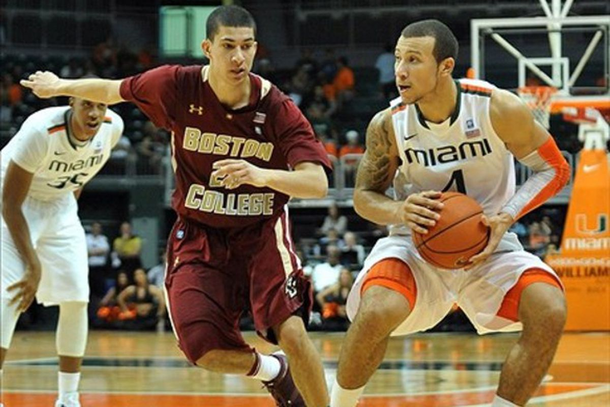 March 3, 2012; Coral Gables, FL, USA; Miami Hurricanes guard Trey McKinney Jones (4) is pressured by Boston College Eagles guard Lonnie Jackson (20) during the second half at the BankUnited Center. Mandatory Credit: Steve Mitchell-US PRESSWIRE