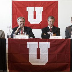 Randy Dryer, left, who leads the Board of Regents of the University of Utah, University President Michael Young, U. Athletic Director Chris Hill and Pac-10 Commissioner Larry Scott have a laugh during a press conference announcing the university's acceptance of the invitation to join the Pac-10 Athletic Conference at Rice-Eccles Stadium in Salt Lake City Thursday.