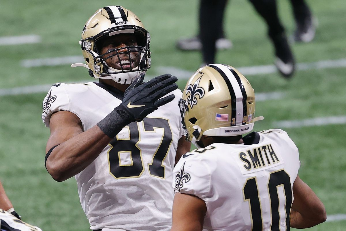 Jared Cook #87 of the New Orleans Saints reacts after the second quarter touchdown reception against the Atlanta Falcons at Mercedes-Benz Stadium on December 06, 2020 in Atlanta, Georgia.