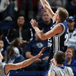 BYU guard Tyler Haws (23) puts up a shot against Air Force.