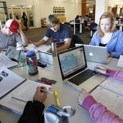 Students Eric Gausseres, left, Adrian Feolo, Maggie Goertzen and others study at The University of Utah's J. Willard Marriott Library in Salt Lake City Wednesday, Jan. 21, 2015.