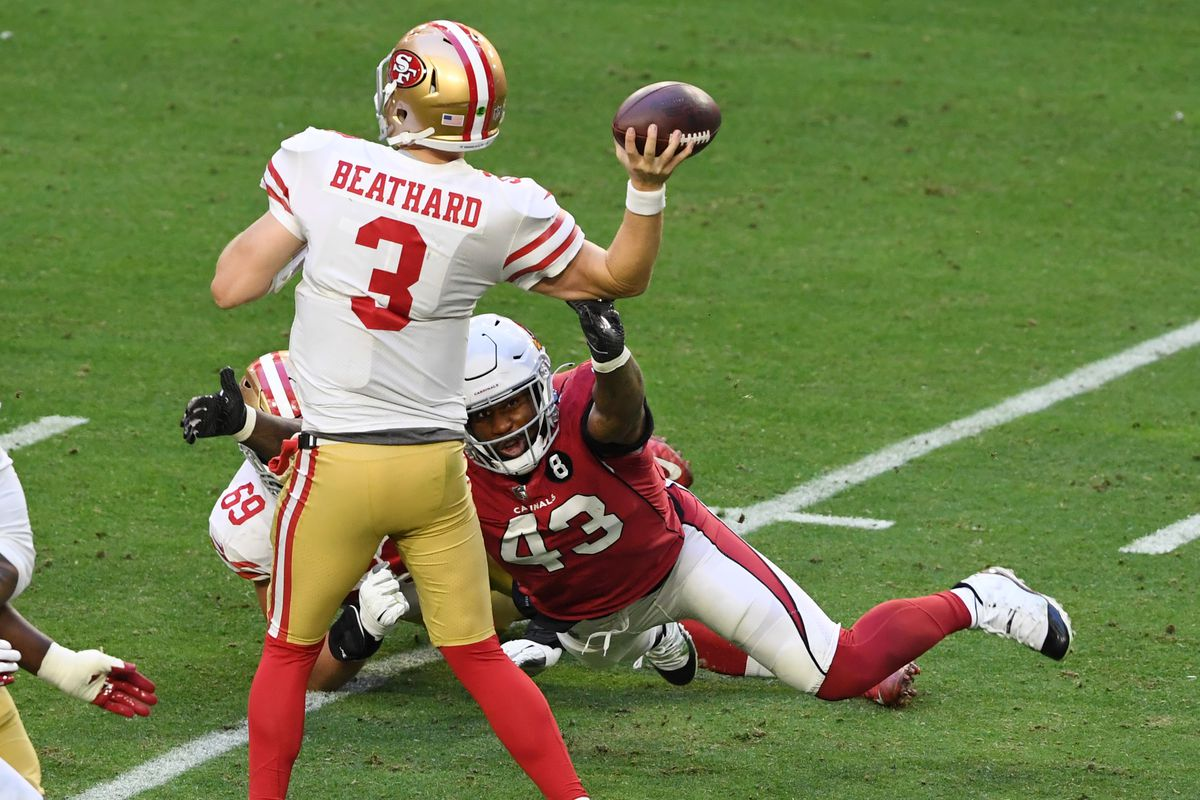 Haason Reddick #43 of the Arizona Cardinals hits the arm of CJ Beathard #3 of the San Francisco 49ers and causes a fumble at State Farm Stadium on December 26, 2020 in Glendale, Arizona.