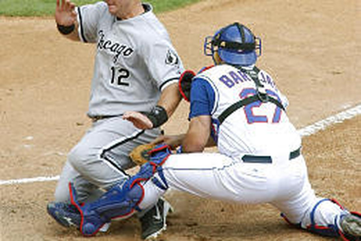 Chicago's A.J. Pierzynski, left, tries to score past Texas catcher Rod Barajas during Wednesday play.