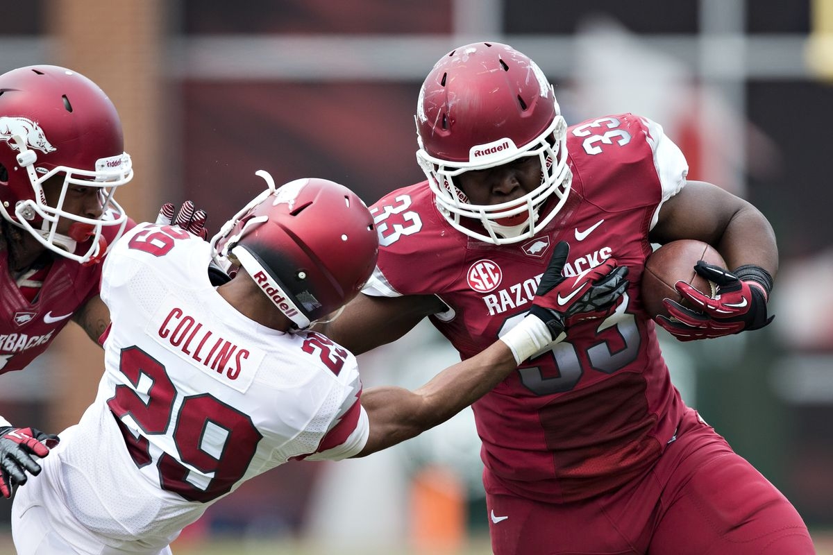 Not the most flattering picture of Jared Collins, the recipient of a Patrick Arinze's Heisman pose.