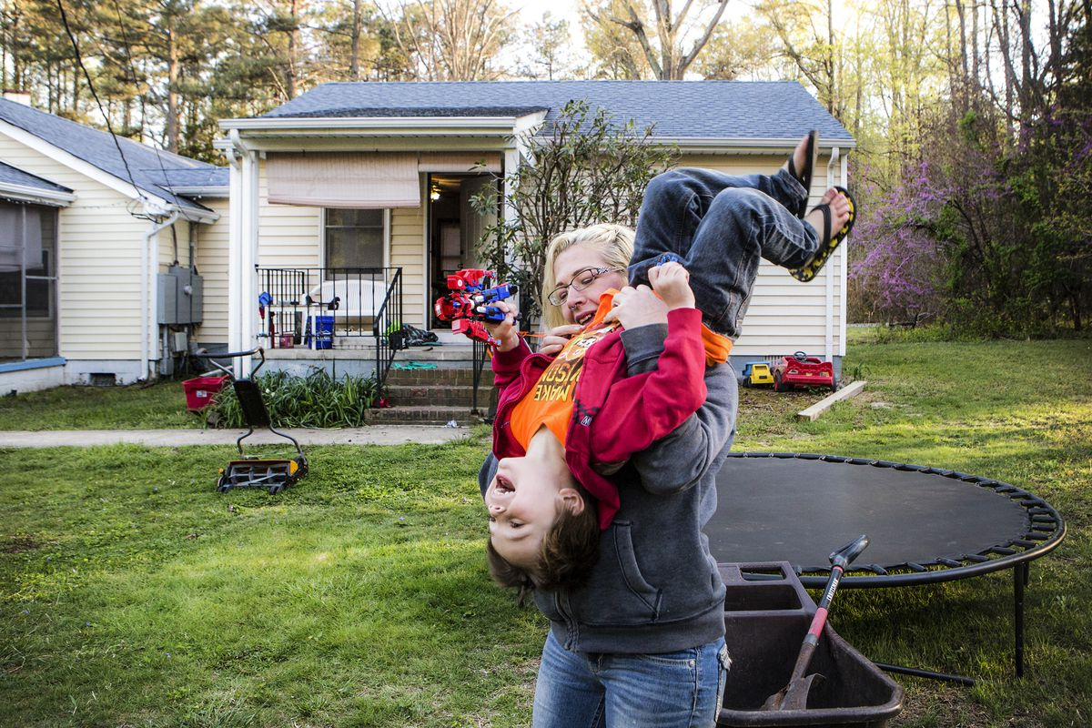 April 19: Fawn Ricciuti, 32, plays with her son Aiden, 5, in her yard outside of Richmond, Virginia. Ricciuti, uses Suboxone to stay off heroin and manage her chronic pain. Read More. (Julia Rendleman for Vox)
