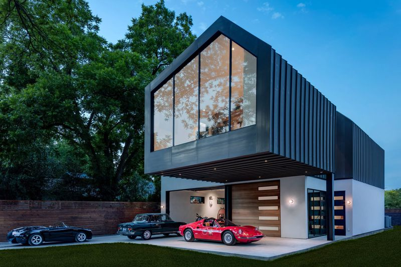 modern home was designed for the car lover curbed - Modern Home Building