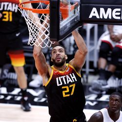 Utah Jazz center Rudy Gobert (27) goes up for a dunk as the Utah Jazz and the Miami Heat play an NBA basketball game at Vivint Smart Home Arena in Salt Lake City on Saturday, Feb. 13, 2021. Utah won 112-94.