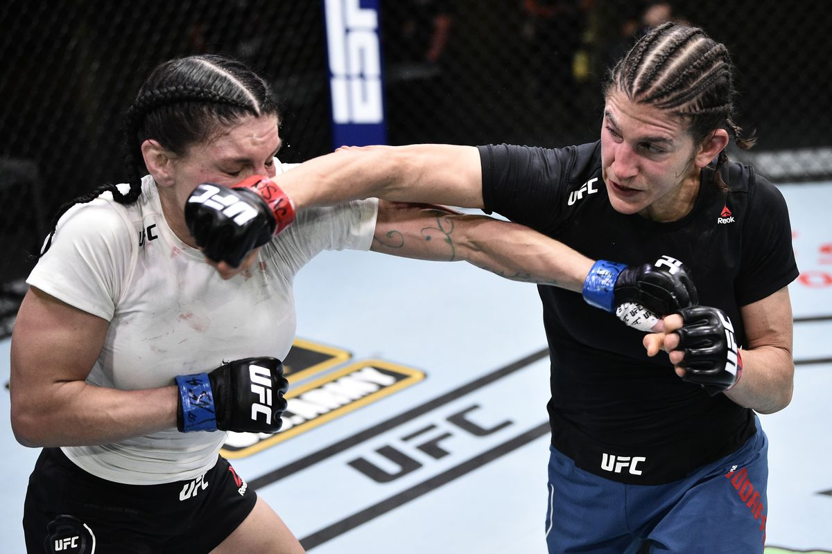 Roxanne Modafferi punches Lauren Murphy in their flyweight bout during the UFC Fight Night event at UFC APEX on June 20, 2020 in Las Vegas, Nevada.