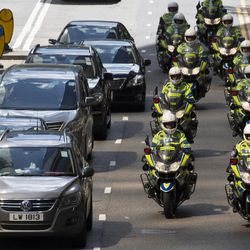 Traffic police on motorcycles ride in formation during a visit by the Chinese President in Hong Kong, Thursday, June 29, 2017. Hong Kong is planning a big party as it marks 20 years under Chinese rule. Fireworks, a gala variety show and Chinese military displays are among the official events planned to coincide with a visit by Xi starting Thursday for the occasion.