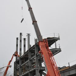 Another girder going up to the jumbotron structure -