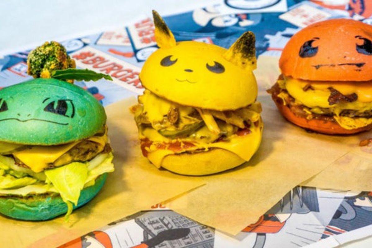 Three Pokemon character-themed burgers with green, yellow, and orange colored hamburger buns