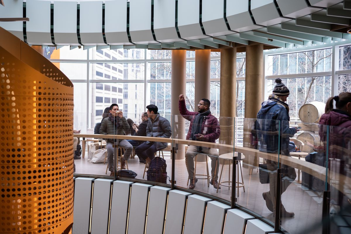 Customers check out Starbucks' 35,000-square-foot Reserve Roastery on Michigan Avenue, which opened Friday.