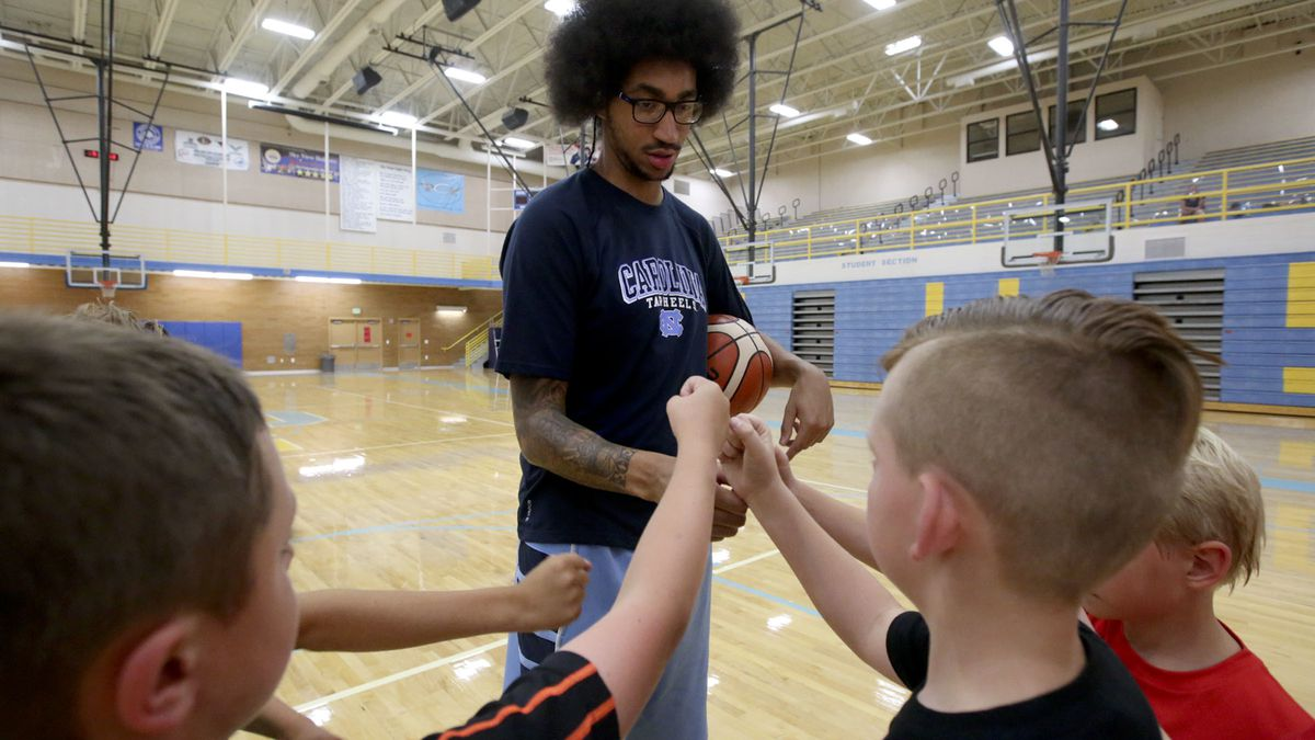 Jalen Moore coaches six boys during a Next Level Basketball training session at the Smithfield Recreation Center in Smithfield, Cache County, on Monday, Aug. 6, 2018.