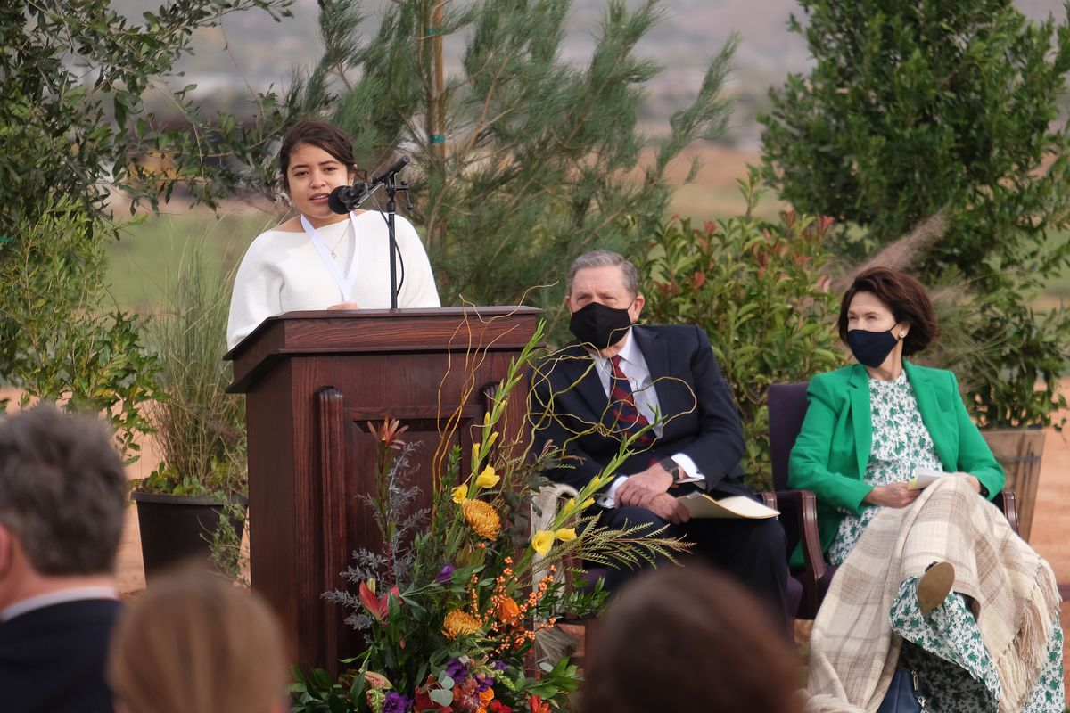 Jacquelin Espinoza Ramos delivers a testimony at the groundbreaking service for the Red Cliffs Utah Temple of The Church of Jesus Christ of Latter-day Saints in St. George, Utah, Saturday, Nov.7, 2020. At right are Elder Jeffrey R. Holland, of the church's Quorum of the Twelve, and his wife Sister Patricia Holland.