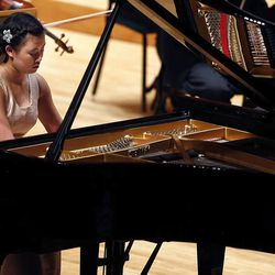 Sanne Jane Christensen performs on the piano during the 55th annual Salute to Youth concert in Salt Lake City Tuesday, Sept. 30, 2014.