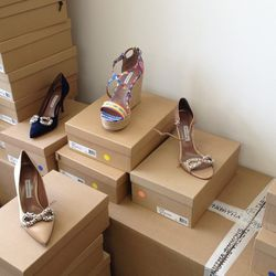 Center, back: Jenny espadrille in Peruvian silk, $195. Left, right and center, forward: Jayne pump in black and nude, $145.